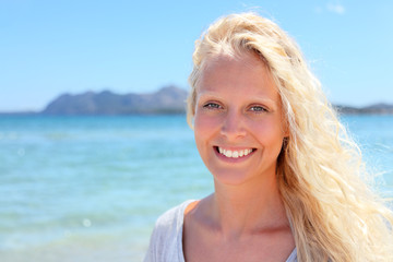 Blonde woman portrait outdoors on beach