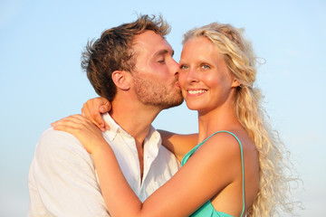 Kissing romantic couple in love smiling happy