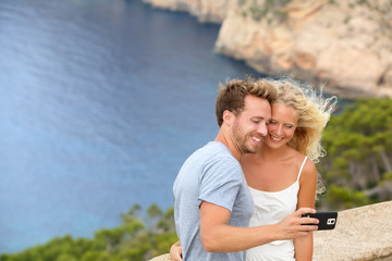 Dating travel couple taking selfie photo picture