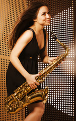 young pretty woman with saxophone