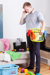 Businessman collecting dirty clothes