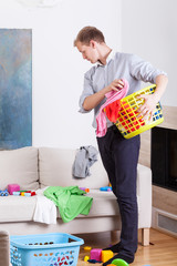 Working father before doing laundry