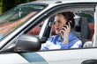 Female driver calling on mobile phone