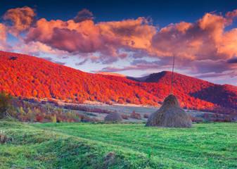 Dramatic autumn sunset in the mountain village