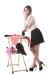 Woman Covering Mouth While Ironing