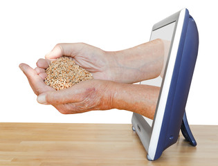 peasant handful with grains leads out TV