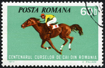 stamp printed by Romania, shows horse races