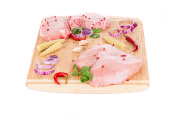 Meat composition on wooden platter.