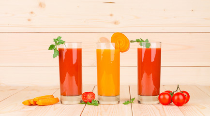 Two juices of tomato and carrot.