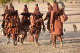 Himba women go back to the village near Opuwo town in Namibia