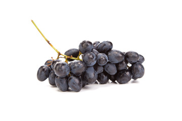 Bunch of ripe and juicy black grapes.