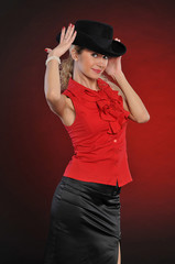Portrait young woman  in black hat in studio