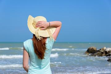 Long hair girl looking at the sea