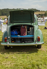 Morris Minor Classic car parked in a field with boot open