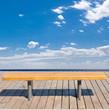 canvas print picture - banc face à la mer et au ciel