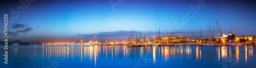 Foto Spatwand Stad aan het water Panoramic sunset of cityscape with reflection in the sea