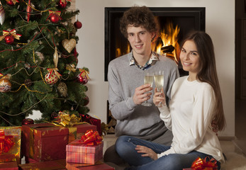 Happy young couple in Christmas interior