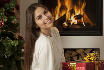 Pretty young woman in Christmas interior
