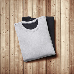 Two blank jumpers on wood background