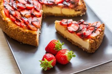New York Cheesecake with Chocolate and Strawberries