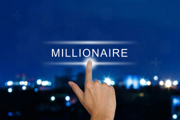 hand pushing millionaire button on touch screen