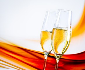 a pair of champagne flutes on blur light background
