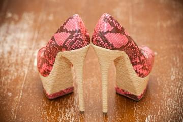 Women shoes pink high heels. Stylized snake skin. Vintage style