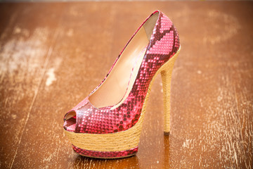 Women shoes pink high heels. Stylized snake skin. Vintage style