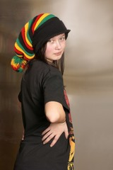 Teenager in Rasta cap on his head