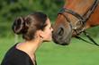 canvas print picture - Junge Frau küsst ihr Pferd