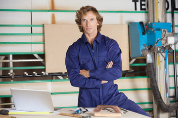 Confident Carpenter With Arms Crossed