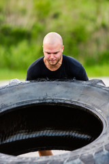 Determined Athlete Flipping Truck Tire
