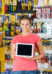 Woman Displaying Digital Tablet In Hardware Shop