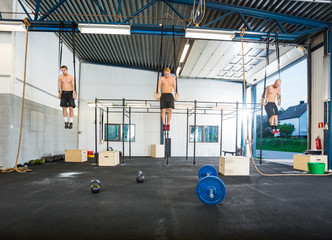 Athletes Exercising On Gymnastic Rings