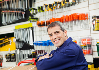 Mature Worker Leaning In Hardware Shop