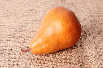 Closeup photo of pear on sackcloth