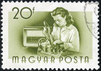 stamp printed in Hungary shows Radio assembler