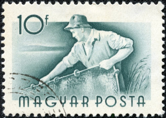 stamp printed in Hungary shows Fisherman pulls net