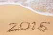 Leinwanddruck Bild - Inscription of 2015 on a sand beach
