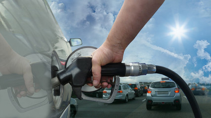 holding a fuel nozzle - highway clouds sun - 16 to 9 - g1755