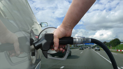holding a fuel nozzle - highway - 16 to 9 - g1753