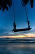 Leinwanddruck Bild - Empty Swing at Sunset