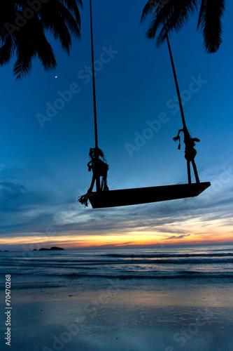 Leinwanddruck Bild Empty Swing at Sunset