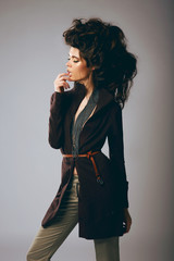 Vogue. Classy Fashion Model in Stylish Brown Jacket and Pants