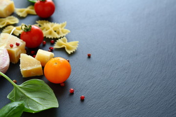 ingredients for pasta to slate background