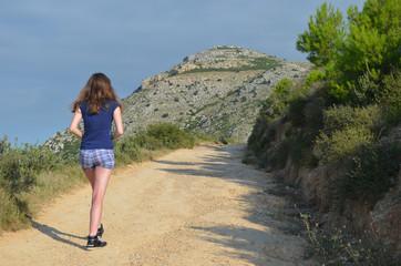 girl walking up mountain
