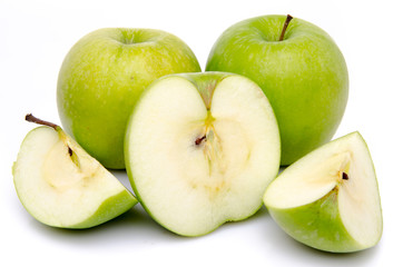 Ripe green apples with slices