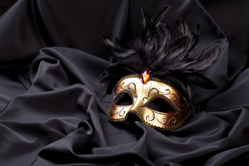 carnival mask on black silk