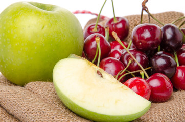 Composition with ripe green apple and cherries