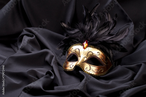 Fotobehang Carnaval carnival mask on black silk